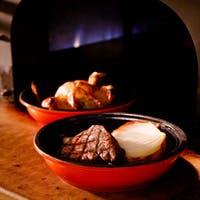 豊富に取り揃えた自慢のお酒と共に美味しい石窯グリル料理を存分にお楽しみください